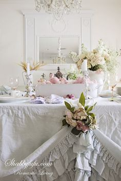 Use a beautiful Duvet cover as your table dressing/linens