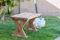 DIY 2x4 x-leg bench outdoors on the grass.