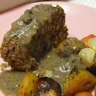 Foto recept: Vegetarisch gehaktbrood met champignonsaus