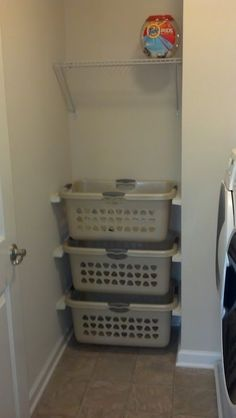Laundry organization. Baskets on wall