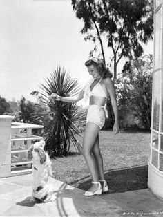 rita hayworth | Rita Hayworth posed in A Swimwear with A Dog Photo by Movie Star News ...