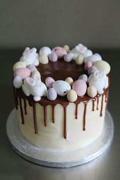 Easter Drip Cake with bunnies, eggs, buttercream frosting, and chocolate drip.