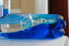 Buy: Waterbottles, baby oil & blue food coloring.   Add food coloring to water, do 50/50 water and oil, hot glue lids shut.