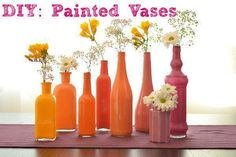 "Looking for the perfect centerpiece for your outdoor wedding or your backyard style wedding? I think this painted vase DIY tutorial is just the right project for a bride looking to add a little color to her wedding tables without having to spend a fortune  One of the things that I really love about this project is that you get a chance to ""up-cycle"" some glass bottles and make them into the perfect wedding centerpiece. This project is not only great for a country wedding but it is also…"