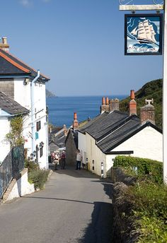Cornwall, UK - View down the hill that leads to the harbour in Portloe. On the left is the Ship Inn - orignally a 17th century fisherman's cottage it became a pub in the late 1800s