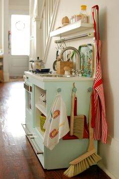 play kitchen - good use of space on the ends for hanging toy storage