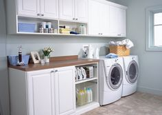 the cabnets are at a taller hieght that makes sence when your folding no bending over to fold  transFORM | The Art of Custom Storage - Laundry Room Cabinets
