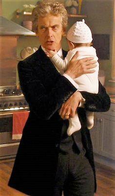 I love this the Doctor holding a baby AHHHHHH so cute