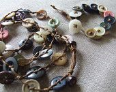 Sets: bracelet and necklace long strand, made with vintage buttons medium size and leather color waxed cord.