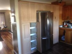 Oak pantry with rollout shelves