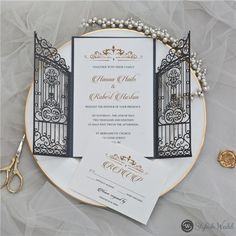 Adding similar elements, as shown in this invite, like a crown design, or an elegant calligraphy-inspired font (if calligraphy isn't exactly in your budget!), and keeping the color palette simple and classic (golds, whites, blacks) are all ways you can easily get that royal look. Blush Pink Wedding Dress, Wedding Dress Organza, Red Wedding Dresses, Long Bridesmaid Dresses, Wedding Outfits, Lavender Bridesmaid, Simple Wedding Bands, Laser Cut Wedding Invitations, Event Invitations