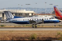 United Express (SkyWest Airlines) Embraer EMB-120ER Brasilia  Los Angeles - International (LAX / KLAX) USA - California, August 27, 2013