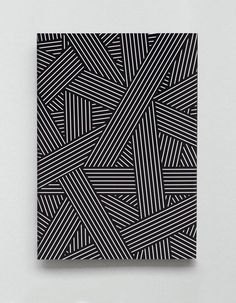 GRAPHIC NOISE The legacy of Bauhaus lives on in graphic black, white and grey / Splicing stripes / Dark, surreal feel with heavy, imposing shadows / Stripes break out into loose, wavy lines / Maze of graphic lines / Stripes also built into 3-D type to create a shattered patchwork print:
