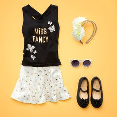 Toddler girls fashion | kids' clothes | Graphic tank top | Palm tree skort | Flats | Round sunglasses | Flower headband | Vacation outfit inspo | The Children's Place
