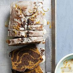 Impress your family with this beautiful marble cake recipe. Pumpkin and chocolate are swirled together and topped with a powdered sugar and orange icing to make the best chocolate pumpkin cake you've ever had.