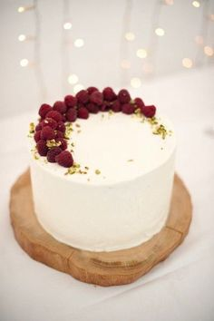 Simple  Wedding Cake Topped With Raspberries & Pistachios