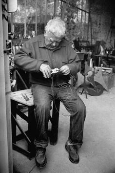 Alexander Calder fashioning a self-portrait in wire at his studio in Sache, France, 1968. Photo by Gjon Mili