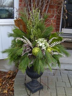 christmas urns outdoors outdoor planters how to make Christmas Urns, Christmas Planters, Christmas Arrangements, Outdoor Christmas Decorations, Christmas Holidays, Christmas Wreaths, Christmas Crafts, Holiday Decor, Christmas Urn Fillers