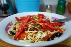 """Raw Zucchini """"pasta"""" with marinated veggies and marinara."""