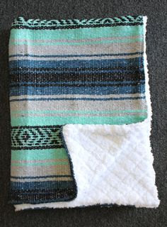 The perfect combination of style and utility. Each blanket is hand made with a Del Mex Mexican baja blanket on one side and a super soft sherpa material on the other. Great as a baby blanket, stroller