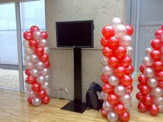 1.8 Metre coloums with a mixture of pearl red and silver balloons