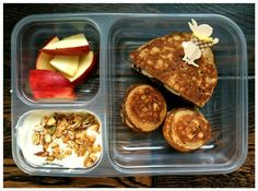 "Half of whole-wheat banana pancake sandwich with cream cheese in the middle, 2 whole-wheat ebleskiver ""round"" pancakes, organic apples, plain yogurt mixed with a little maple syrup, vanilla extract, bananas, and homemade granola"