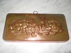 Vintage Copper mold of bunnies....