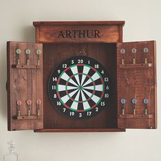Buy the Personalized Dart Board Cabinet at Wine Enthusiast – we are your ultimate destination for wine storage, wine accessories, gifts and more! Dart Board Cabinet, Dart Board Backboard, Game Room Basement, Basement Ideas, Rustic Basement Bar, Man Cave Basement, Basement Renovations, Basement Furniture, Man Cave Furniture