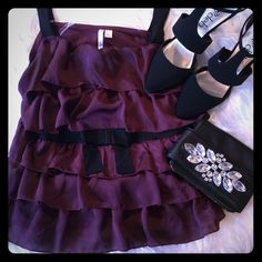 """Plum Lauren Conrad tank. This silky purple tank has black accents, a small bow at the waist, and two black straps. 5 ruffles. Length: 24.75"""",  bust: 19"""". Stretchy tee shirt back. Great condition. Small amount of darkening at the armpits. Shown in picture. Lauren Conrad Tops Tank Tops"""