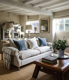 Homes & Antiques. Jason Ingram. Soft corners, chalky shades on the walls and beams, natural textiles, muted, harmonious palette.