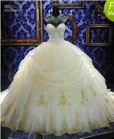 Ball Gown | White and gold wedding dress. Fit for a queen!