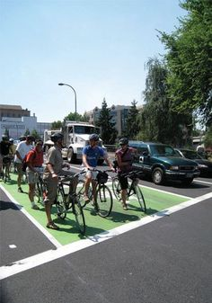 Bike box (Portland) – designated areas at the head of a traffic lane that provides bicyclists with a safe and visible way to get ahead of stopped traffic at a red light.