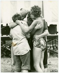 Women embracing at Michigan Womyn's Music Festival, 1976, photo by diana davies