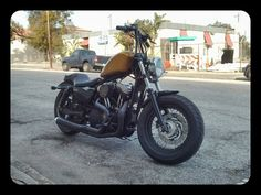 48 Harley with La Pera seat, large tank, and apes.