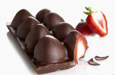 Ice tray + strawberries + melted chocolate = Homemade chocolated covered strawberries.