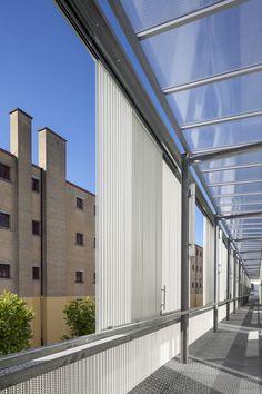 Scharnier mit Durchsicht - Sanierung und Erweiterungsbau in Mons