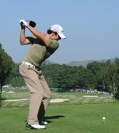 See the left arm reach across the body for a full backswing. #ImproveYourGolfGame
