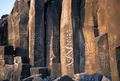 Ancient Native American rock carvings (petroglyphs) on the basalt along the Gila River near Malusa, Arizona.