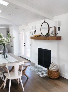 Get Inspired: The DIY White Brick Fireplace (Love this one in a Dining Room!) It's time to get inspired by these white brick fireplaces! A white fireplace will help to brighten a room and will give the fireplace a more modern feel. Living Room Decor, Living Spaces, Style At Home, Home And Deco, Home Fashion, Home Interior, Bathroom Interior, Interiores Design, Modern Farmhouse