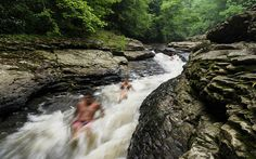 Ohiopyle State Park in Pennsylvania has several natural wonders, one of which is a natural water slide at Meadow Run.