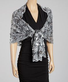 LOVE! LOVE! LOVE! LOVE! LOVE! LOVE! OMGOSH! I ADORE THIS SHAWL! Create a truly captivating wardrobe by layering a wrap that boasts sophisticated style with its rich color, sequin details and lighter-than-air construction.