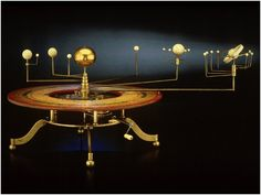 An orrery is a mechanical device that illustrates the relative positions and motions of the planets and moons in the solar system in a heliocentric model