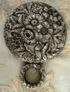 Repousse Sterling Hand Mirror