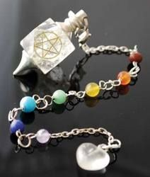 Clear Quartz Chakra Pentagram - Carved of a clear quartz stone this faceted pendulum bob is inscribed with a pentagram and attached to a chain featuring 7 stones representing the 7 chakras.  Styles vary our choice.
