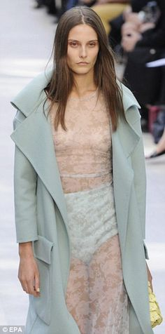 Burberry S/S 2014  Soft with underlying sassiness: Cocooning overcoats, delicate lace