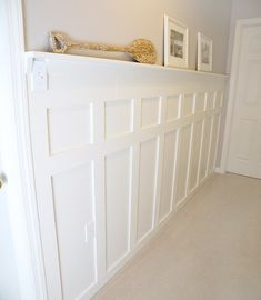 After much online searching, I decided to do an inexpensive board and batten wall treatment in our upstairs hallway, with a narrow shelf at the top where I coul… Wainscoting Nursery, Faux Wainscoting, Wainscoting Ideas, Dining Room Wainscoting, Living Tv, Living Rich, Striped Room, Narrow Shelves, Reclaimed Doors