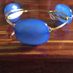 Bourbon and bow ties inspired bangle Large, blue acrylic beads on gold wire. Size large Jewelry Bracelets