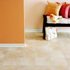 Laminate look stone tiles for floors Like Real Stone  For all their natural beauty, stone and tile are still cold, hard flooring surfaces. Laminate offers look-alike designs that are warmer underfoot (nice in the bathroom) and more forgiving when items are dropped (ideal in the kitchen). Look for laminate tiles with beveled edges that suggest grout lines and embossed textures that resemble natural stone.