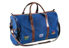Start planning your weekend escape. This unisex kilim textile weekender bag is strong, sturdy and stylish, with colorful hand woven accents and handsome leather trim. A detachable cross body strap, exterior side pockets and an interior zip pocket add functional appeal.
