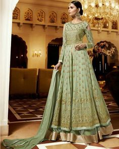 Pastel green lehenga kameez with dupatta. Fabric - Royal georgette (top) and net (lehenga). Work - Resham and zari embroidery, buttis and patch border. Kameez length is approximately inches. Paired with the matching bottom and dupatta. Lehenga Anarkali, Long Choli Lehenga, Lehenga Suit, Green Lehenga, Lehenga Style, Anarkali Suits, Silk Lehenga, Bridal Lehenga, Designer Salwar Suits